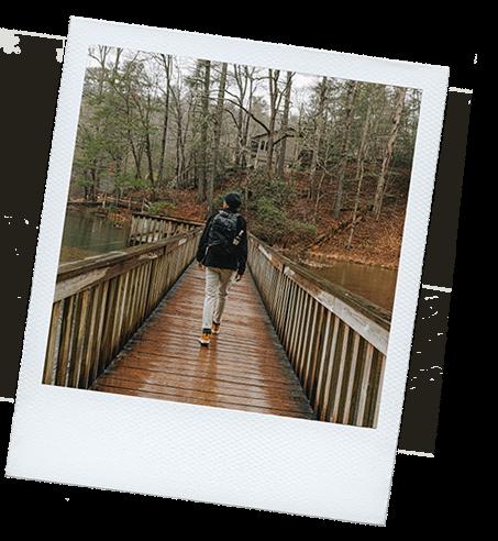 Person walking on a bridge